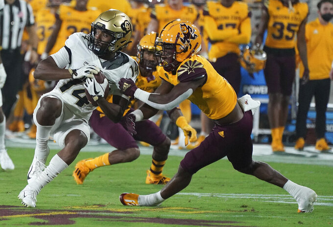Arizona State defensive back Jordan Clark (1) drags down Colorado State wide receiver Dimitri Stanley (14) during the first half of an NCAA college football game  Saturday, Sept 25, 2021, in Tempe, Ariz. (AP Photo/Darryl Webb)
