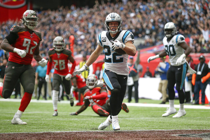 Carolina Panthers running back Christian McCaffrey (22) crosses the goal line to score a touchdown against the Tampa Bay Buccaneers during the second quarter of an NFL football game, Sunday, Oct. 13, 2019, at Tottenham Hotspur Stadium in London. (AP Photo/Tim Ireland)