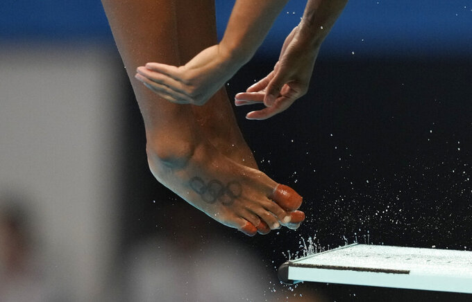 Jennifer Abel of Canada competes in women's diving 3-meter springboard final at the Tokyo Aquatics Centre at the 2020 Summer Olympics, Sunday, Aug. 1, 2021, in Tokyo, Japan. (AP Photo/Dmitri Lovetsky)