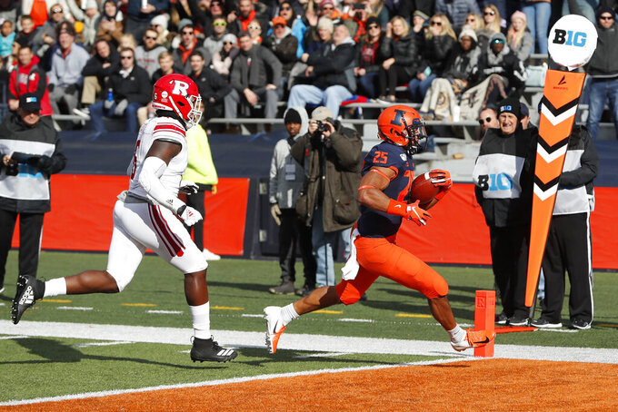 Illinois running back Dre Brown (25) scores past Rutgers linebacker Rashawn Battle during the first half of an NCAA college football game Saturday, Nov. 2, 2019, in Champaign, Ill. (AP Photo/Charles Rex Arbogast)