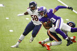Minnesota Vikings wide receiver Justin Jefferson (18) is tackled by Chicago Bears linebacker Roquan Smith (58) and safety Eddie Jackson, right, after catching a pass during the first half of an NFL football game, Sunday, Dec. 20, 2020, in Minneapolis. (AP Photo/Bruce Kluckhohn)