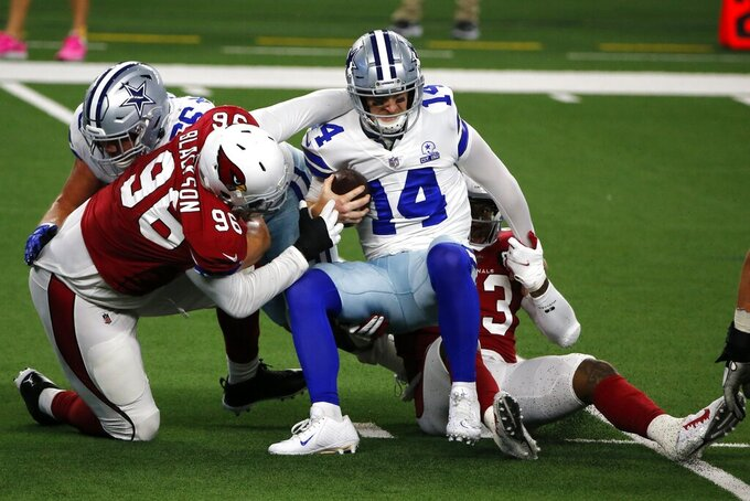 Arizona Cardinals defensive end Angelo Blackson (96) and Haason Reddick, right, combine to sack Dallas Cowboys quarterback Andy Dalton (14) in the first half of an NFL football game in Arlington, Texas, Monday, Oct. 19, 2020. (AP Photo/Michael Ainsworth)