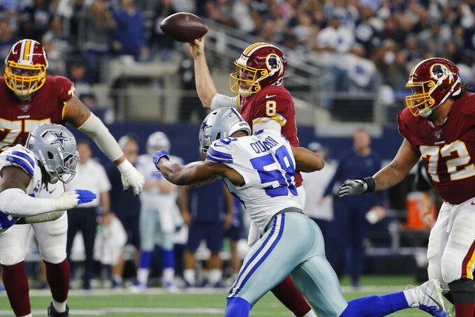 Washington Redskins quarterback Case Keenum (8) is pressured by Dallas Cowboys defensive end Robert Quinn (58) during the first half of an NFL football game in Arlington, Texas, Sunday, Dec. 15, 2019. (AP Photo/Michael Ainsworth)