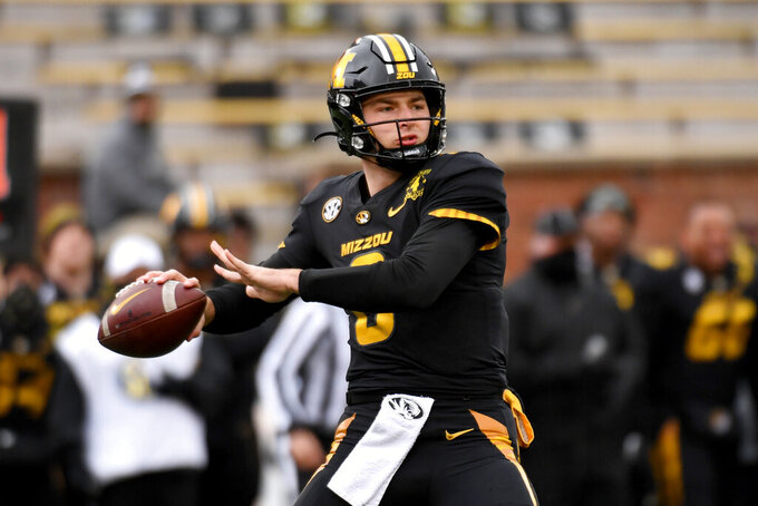 Missouri quarterback Connor Bazelak throws during the first half of an NCAA college football game against Georgia Saturday, Dec. 12, 2020, in Columbia, Mo. (AP Photo/L.G. Patterson)