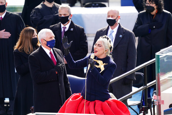 Lady Gaga sings the National Anthem during the 59th Presidential Inauguration at the U.S. Capitol for President-elect Joe Biden in Washington, Wednesday, Jan. 20, 2021. Former Vice President Mike Pence is on left. (Kevin Dietsch/Pool Photo via AP)