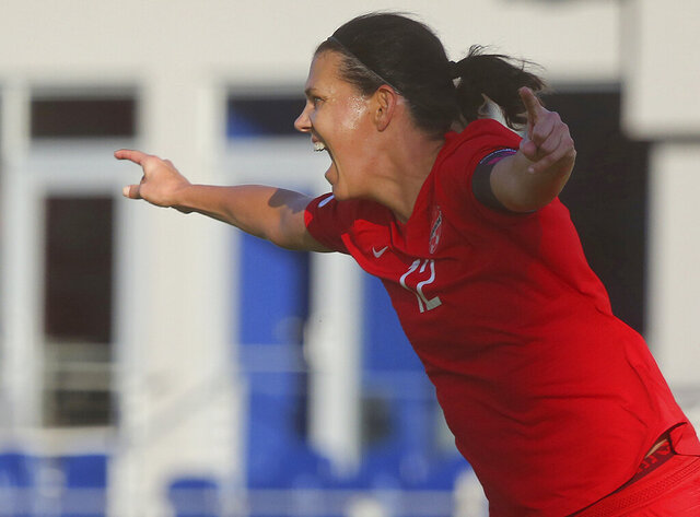Canada's Christine Sinclair celebrates after scoring against St. Kitts and Nevis in a CONCACAF Olympic qualifying match Wednesday, Jan. 29, 2020, in Edinburg, Texas. Sinclair broke Abby Wambach's record of 184 goals. (AP Photo/Joel Martinez)