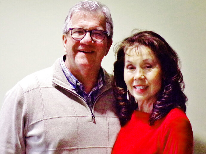 This Nov. 20, 2019 photo shows Doug and Julie Henning  at Pearl S. Buck Institute in Hilltown, Pa.  Julie Henning has told her life story at churches, schools, civic groups and conferences, sharing about coming from poverty in her native Korea to Bucks County and being raised as Nobel and Pulitzer prize winning author Pearl S. Buck's daughter. Now, Henning has written about it in a new memoir,