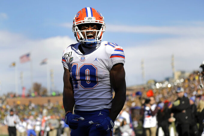 Florida wide receiver Josh Hammond celebrates after catching a touchdown pass during the second half of an NCAA college football game against Missouri Saturday, Nov. 16, 2019, in Columbia, Mo. Florida won 23-6. (AP Photo/Jeff Roberson)