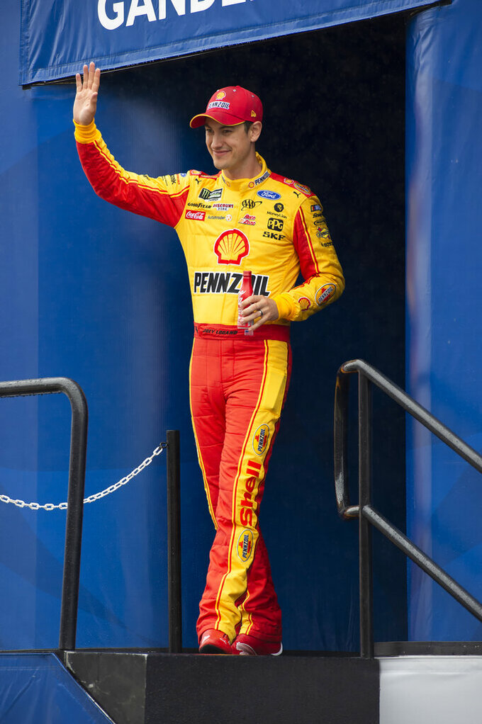 Joey Logano waves during driver introductions at a NASCAR Cup Series auto race Sunday, May 5, 2019, at Dover International Speedway in Dover, Del. (AP Photo/Jason Minto)