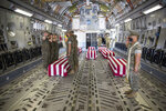 U.S. Marines and sailors render a final salute to the fallen inside a U.S. Air Force C-17 Globemaster III at Marine Corps Air Station Miramar, in Calif., Wednesday, Aug. 12, 2020. The remains of seven Marines and a sailor, who died after a seafaring tank sank off the coast of Southern California last month, were transferred to Dover Air Force Base in Delaware for burial preparations.  (Lance Cpl. Brendan Mullin/U.S. Marine Corps via AP)