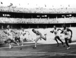FILE - In this Nov. 23, 1956, file photo, United States' Bobby Joe Morrow (55) crosses the finish line of the men's 100-meter race in 10.5 seconds, equaling an Olympic record, during the Summer Olympics in Melbourne, Australia. (AP Photo/File)