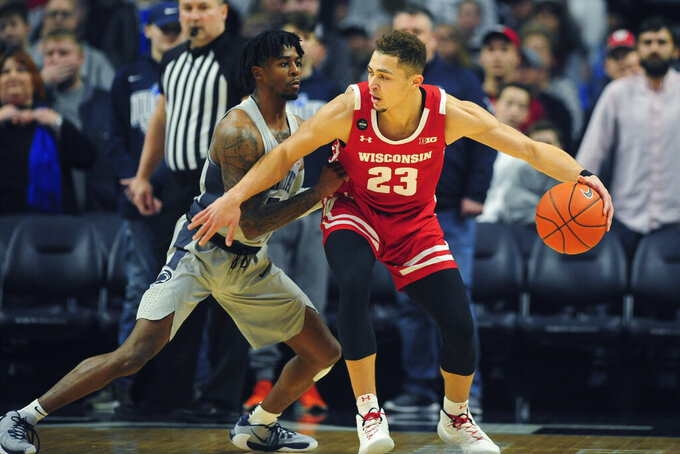 Wisconsin's Kobe King (23) works against Penn State's Jamari Wheeler (5)in first half action of an NCAA college basketball game, Saturday, Jan. 11, 2020, in State College, Pa. (AP Photo/Gary M. Baranec)