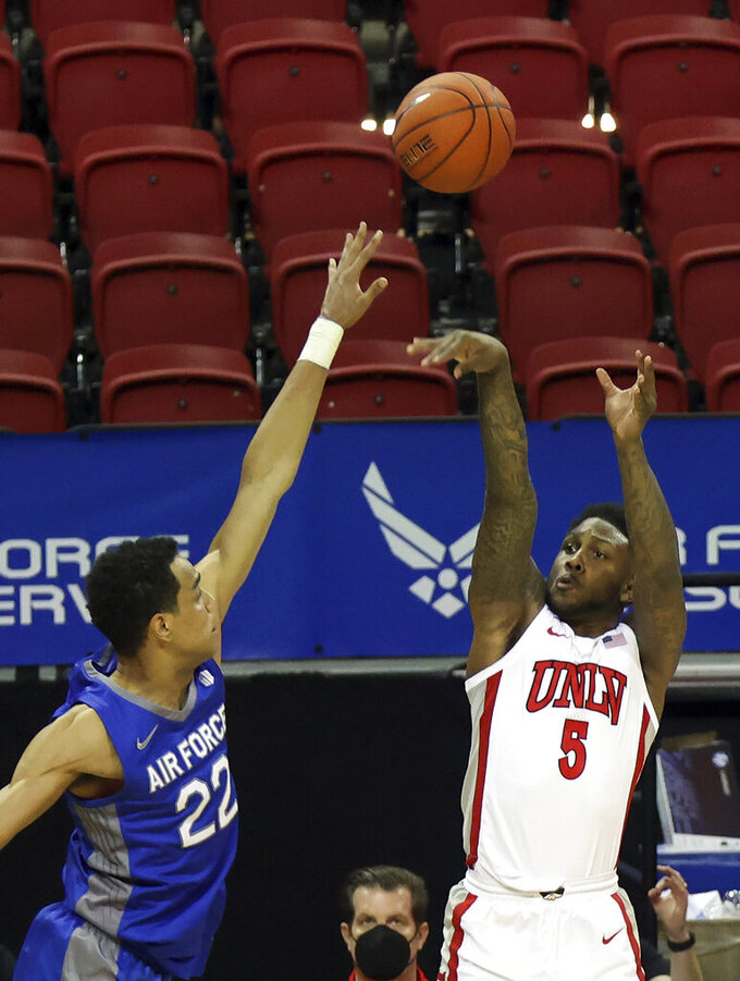 UNLV guard David Jenkins Jr. (5) shoots over Air Force forward Nikc Jackson (22) during the second half of an NCAA college basketball game in the first round of the Mountain West Conference tournament Wednesday, March 10, 2021, in Las Vegas. (AP Photo/Isaac Brekken)