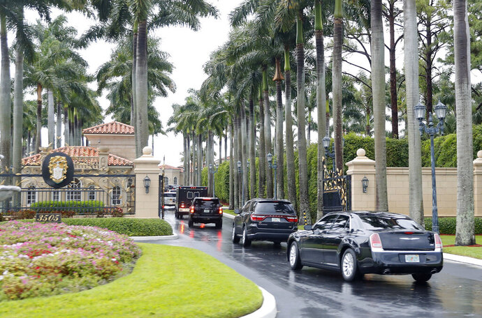 President Donald Trump and his accompanying motorcade vehicles arrive at Trump International Golf Club, Friday, April 19, 2019 in West Palm Beach, Fla. (AP Photo/Pablo Martinez Monsivais)