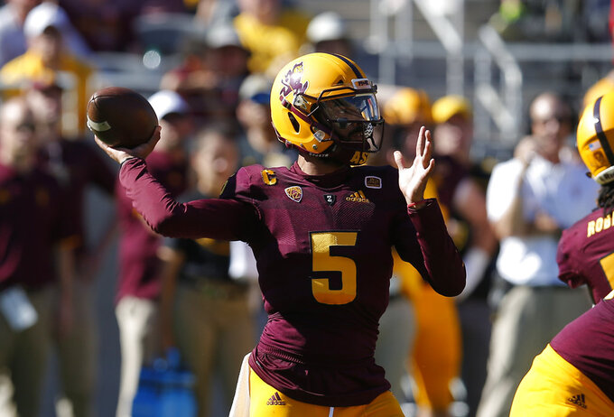 Arizona State quarterback Manny Wilkins throws downfield against Utah in the first half during an NCAA college football game, Saturday, Nov. 3, 2018, in Tempe, Ariz. (AP Photo/Rick Scuteri)