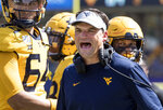 FILE - In this Sept. 14, 2019, file photo, West Virginia head coach Neal Brown yells at a referee during the second half of an NCAA college football game against North Carolina State, in Morgantown, W.Va. West Virginia has lost three straight games and will try to break a three-game losing streak Thursday night at Baylor. (AP Photo/Raymond Thompson, File)