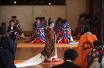 Japan's Emperor Naruhito, center, leaves at the end of the enthronement ceremony where he officially proclaimed his ascension to the Chrysanthemum Throne at the Imperial Palace in Tokyo, Tuesday, Oct. 22, 2019. (Kazuhiro Nogi/Pool Photo via AP)