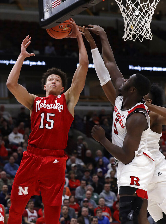 Nebraska forward Isaiah Roby, left, drives to the basket against Rutgers forward Eugene Omoruyi, center, and center Myles Johnson during the first half of an NCAA college basketball game in the first round of the Big Ten Conference tournament in Chicago, Wednesday, March 13, 2019. (AP Photo/Nam Y. Huh)