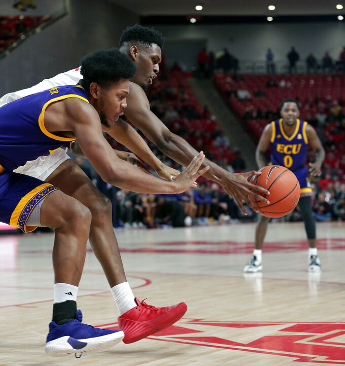 East Carolina forward Jayden Gardner, front, and Houston center Chris Harris Jr., back, chase a loose ball during the first half of an NCAA college basketball game Wednesday, Jan. 23, 2019, in Houston. (AP Photo/Michael Wyke)