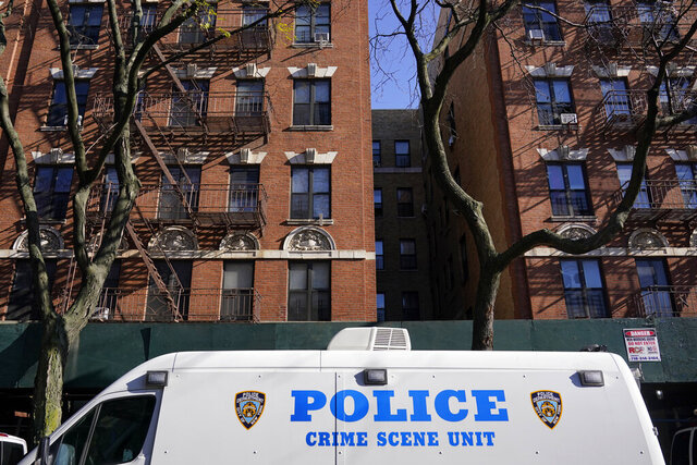 A crime scene unit vehicle is parked near the scene of a shooting in the Brooklyn borough of New York, Monday, Nov. 23, 2020. New York City police said a young woman died and multiple other people were wounded in the shooting at an apartment building in Brooklyn that followed an earlier shooting near a Sweet 16 birthday party. (AP Photo/Seth Wenig)
