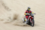 Joan Barreda of Spain rides his Honda motorbike during the first stage of the Dakar Rally between Lima and Pisco, Peru, Monday, Jan. 7, 2019. (AP Photo/Ricardo Mazalan)