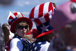 Tonia Garrett sports a flag hat while waiting with friends for the start of former president Donald Trump's Save America rally in Perry, Ga., on Saturday, Sept. 25, 2021. (AP Photo/Ben Gray)