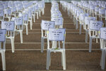 One thousand of chairs symbolizing people died from the coronavirus are placed at the Rabin Square in Tel Aviv, Israel, Monday, Sept. 7, 2020. Israeli Prime Minister Benjamin Netanyahu on Sunday announced overnight curfews on some 40 cities and towns hit hard by the coronavirus, but backed away from reported recommendations for full lockdowns after an uproar by politically powerful religious politicians. The measures were announced late Sunday after hours of consultations with decision-makers. The government has been forced to take new action after failing to contain an outbreak that has claimed more than 1,000 lives and remains at record levels of new infections. (AP Photo/Sebastian Scheiner)