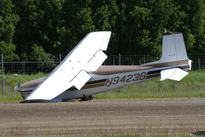 A damaged aircraft is seen at Lake Hood Seaplane Base on Wednesday, June 13, 2018, in Anchorage, Alaska. Alaska State Troopers say two planes were involved in a mid-air collision Wednesday north of Anchorage, with the wreckage of one plane spotted in a river and the other landing at the seaplane base. (AP Photo/Mark Thiessen)