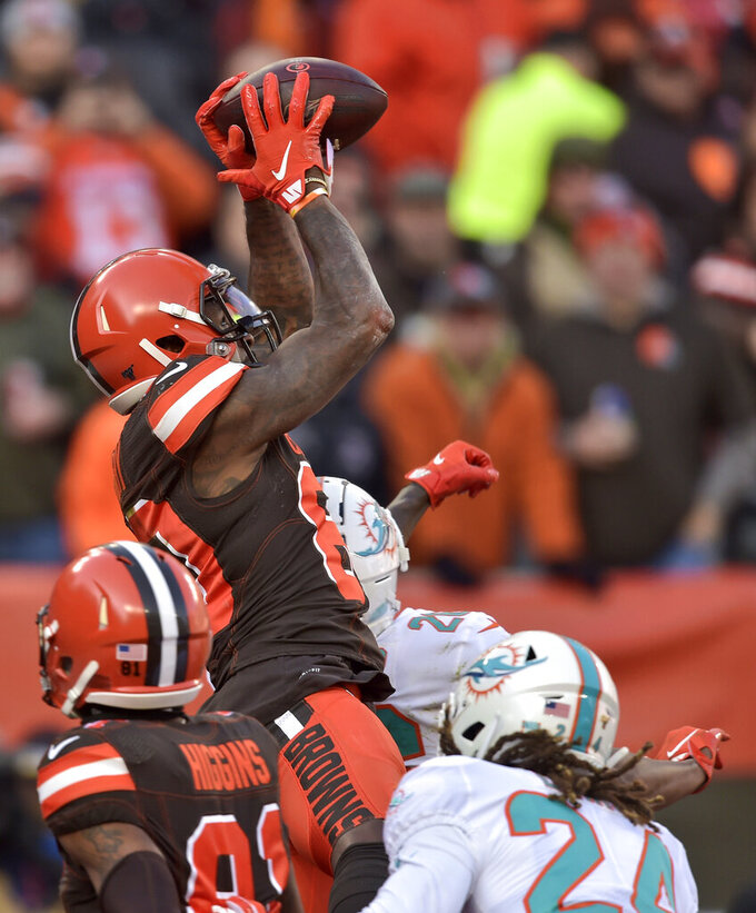 Cleveland Browns wide receiver Jarvis Landry, top, catches a 5-yard touchdown pass during the first half of an NFL football game against the Miami Dolphins, Sunday, Nov. 24, 2019, in Cleveland. (AP Photo/David Richard)