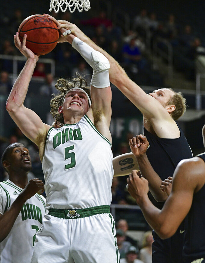 Ohio forward Ben Vander Plas (5) rebounds against Purdue forward Evan Boudreaux during the first half of an NCAA college basketball game, Tuesday, Dec. 17, 2019, in Athens, Ohio. (AP Photo/David Dermer)