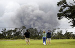 People watch as ash rises from the summit crater of Kilauea volcano, Thursday, May 17, 2018, in Volcano, Hawaii. (AP Photo/Caleb Jones)
