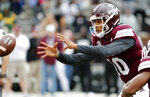 Mississippi State quarterback Keytaon Thompson (10) reaches for the snapped ball during the team's spring NCAA college football game in Starkville, Miss., Saturday, April 13, 2019. (AP Photo/Rogelio V. Solis)
