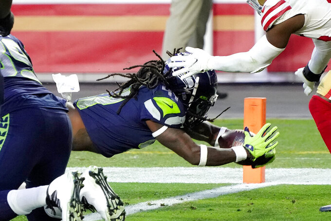 Seattle Seahawks running back Alex Collins scores a touchdown against the San Francisco 49ers during the second half of an NFL football game, Sunday, Jan. 3, 2021, in Glendale, Ariz. (AP Photo/Ross D. Franklin)(AP Photo/Rick Scuteri)
