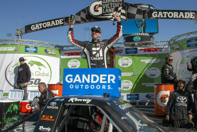 Kyle Busch celebrates career win 201 following the NASCAR Gander Outdoors Truck Series race at Martinsville Speedway in Martinsville, Va. Saturday, March 23, 2019. (AP Photo/Matt Bell)