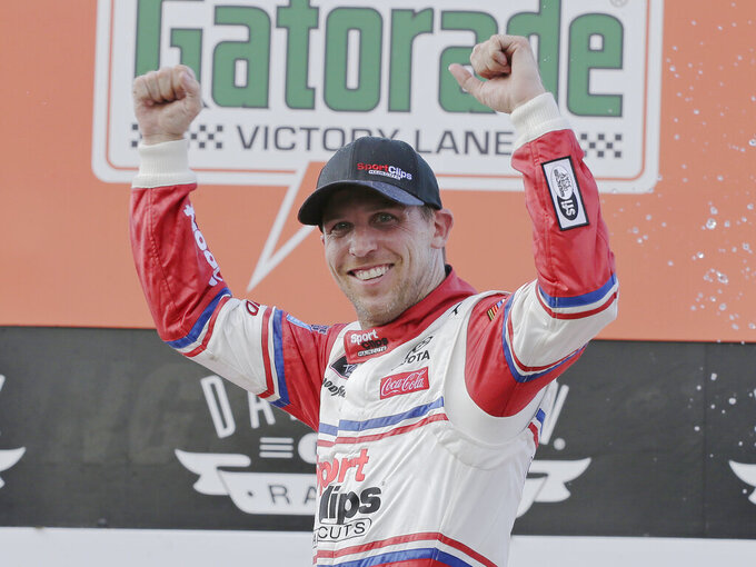 ADD HAMLIN STRIPPED OF WIN - Denny Hamlin celebrates in Victory Lane after winning a NASCAR Xfinity Series auto race on Saturday, Aug. 31, 2019, at Darlington Raceway in Darlington, S.C. Hamlin was stripped of his win after he failed post-race inspection. Cole Custer was declared the winner. (AP Photo/Terry Renna)