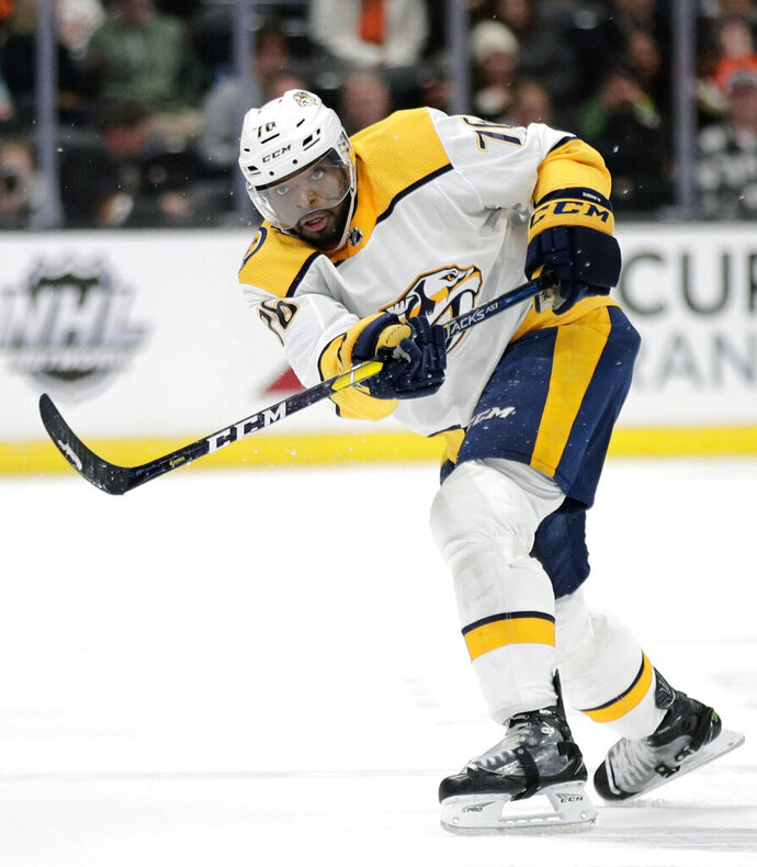 FILE - In this March 12, 2019, file photo, Nashville Predators' P.K. Subban hits the puck during the third period of an NHL hockey game against the Anaheim Ducks, in Anaheim, Calif. The trade talk is just heating up ahead of the draft Friday and Saturday in Vancouver. Nashville's P.K. Subban is among the high-profile players who could be on the move. (AP Photo/Jae C. Hong, File)