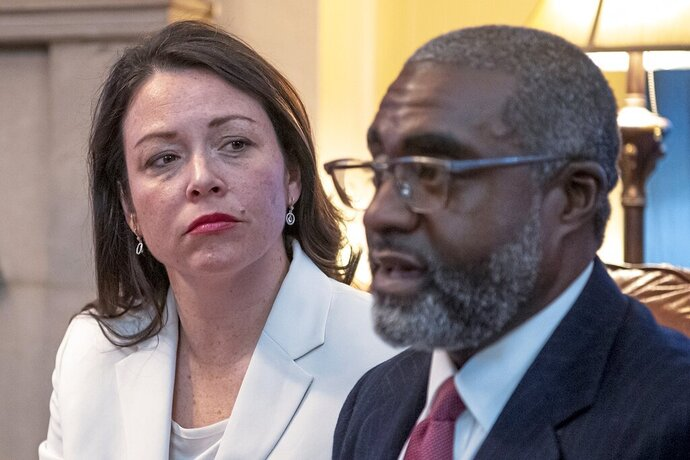 FILE - This March 9, 2019, file photo shows Pennsylvania's Allegheny County Controller Chelsa Wagner and her husband Khari Mosley speaking about their encounter with police while on a trip to Detroit, in their home, in Pittsburgh. Wagner, an elected official from Pittsburgh, and her husband have been charged following an altercation with police in a downtown Detroit hotel. The Wayne County prosecutor's office says Wednesday, March 20, 2019, that 41-year-old Wagner faces felony resisting police and misdemeanor disorderly conduct charges. Wagner's 50-year-old husband, Mosley, is charged with disorderly conduct and disturbing the peace -- both misdemeanors.  (Alexandra Wimley/Pittsburgh Post-Gazette via AP)