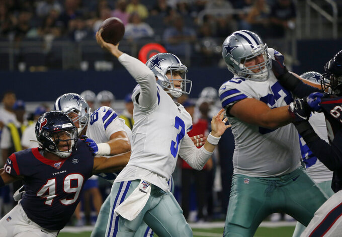 Dallas Cowboys quarterback Mike White (3) throws a pass from the pocket as Houston Texans linebacker Jamal Davis (49) applies pressre in the second half of a preseason NFL football game in Arlington, Texas, Saturday, Aug. 24, 2019. (AP Photo/Michael Ainsworth)