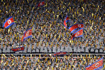 FILE - In this April 7, 2017, file photo, North Korean university students cheer and wave their national flag as their country's women's soccer team competes against South Korea in a qualifying soccer match for the Asian Football Confederation Cup at the Kim Il Sung Stadium in Pyongyang, North Korea. The South Korean men's national soccer team's path to the 2022 World Cup in Qatar will include a crucial road match against North Korea, but it's unclear whether a rare match between the Koreas in Pyongyang will materialize considering the political tension between the rivals. (AP Photo/Jon Chol Jin, File)
