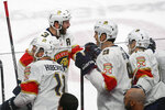 Florida Panthers defenseman Keith Yandle (3) celebrates with Florida Panthers left wing Jonathan Huberdeau (11), Florida Panthers center Brian Boyle (9) and Florida Panthers defenseman Mark Pysyk after Yandle scored against the Minnesota Wild during the first period of an NHL hockey game Monday, Jan. 20, 2020, in St. Paul, Minn. (AP Photo/Craig Lassig)