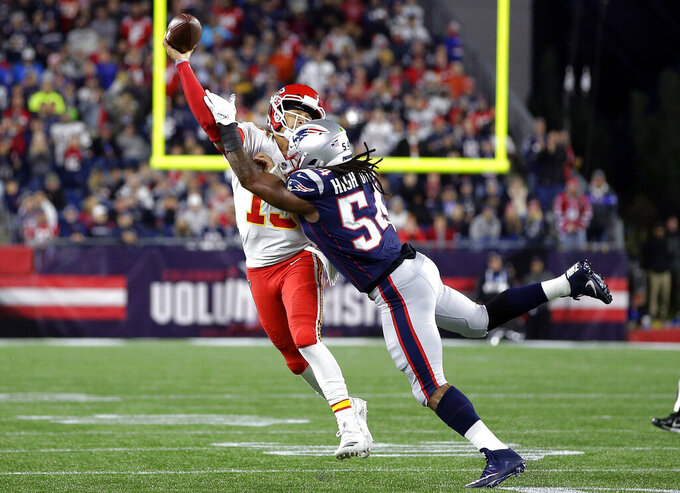 FILE - In this Sunday, Oct. 14, 2018, file photo, New England Patriots linebacker Dont'a Hightower (54) pressures Kansas City Chiefs quarterback Patrick Mahomes (15) as he tries to pass during the first half of an NFL football game in Foxborough, Mass. In three previous meetings with Kansas City's Patrick Mahomes, the Patriots defense has had its most success when it's been able to force turnovers and get pressure on him. But that's easier said than done against a quarterback who has yet commit a turnover this season and is completing a career-high 68% of his passes. (AP Photo/Steven Senne, File)