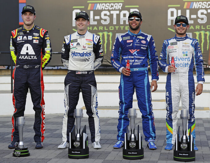 Kyle Larson, Bubba Wallace, William Byron and Alex Bowman, from right, pose with their trophies in Victory Lane after the NASCAR All-Star Open auto race at Charlotte Motor Speedway in Concord, N.C., Saturday, May 18, 2019. Larson, Wallace and Byron won segments of the race and Bowman was voted by fans to move on to the All-Star Race. (AP Photo/Chuck Burton)