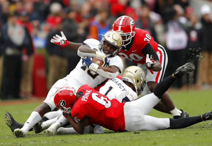 Georgia Tech running back Jerry Howard (15) is tackled by Georgia linebackers Natrez Patrick (6) and Tae Crowder (30) during the first half of an NCAA college football game Saturday, Nov. 24, 2018, in Athens, Ga. (AP Photo/John Bazemore)