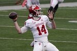 Indiana's Jack Tuttle throws a pass during the first half of an NCAA college football game against Wisconsin Saturday, Dec. 5, 2020, in Madison, Wis. (AP Photo/Morry Gash)