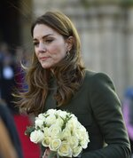 Kate Duchess of Cambridge holds flowers as she meets the members of the public at Centenary Square in Bradford northern England, Wednesday, Jan. 15, 2020. (AP Photo/Rui Vieira)