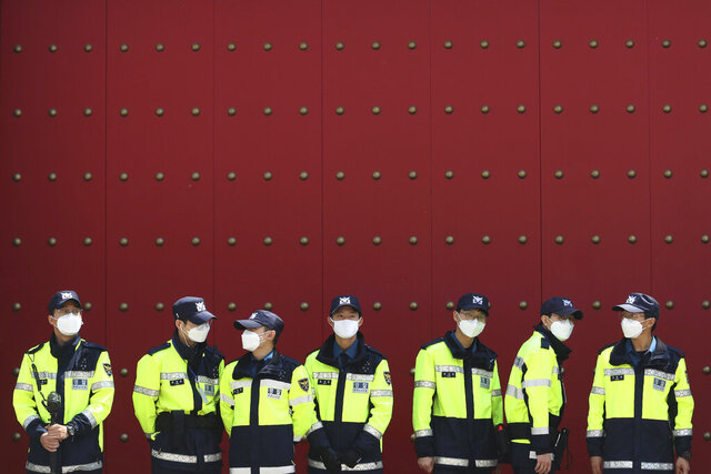 Police officers wearing face masks to help protect against the spread of the new coronavirus stand guard in front of the Chinese embassy in Seoul, South Korea, Wednesday, May 27, 2020. (AP Photo/Ahn Young-joon)