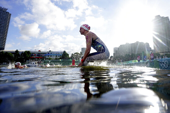 Haley Anderson, of the United States, jumps in the water at the start of the women's marathon swimming event at the 2020 Summer Olympics, Wednesday, Aug. 4, 2021, in Tokyo. (AP Photo/David Goldman)