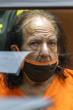 Adult film star Ron Jeremy appears for his arraignment on rape and sexual assault charges at Clara Shortridge Foltz Criminal Justice Center, Friday, June 26, 2020, in Los Angeles. Jeremy pleaded not guilty to charges of raping three women and sexually assaulting a fourth. (David McNew/Pool Photo via AP)