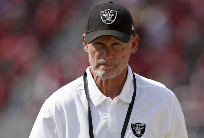 """FILE - In this Aug. 29, 2021, file photo, Las Vegas Raiders general manager Mike Mayock walks on the sideline during at the team's NFL football game against the San Francisco 49ers in Santa Clara, Calif. After failing to post a winning record in three seasons since Jon Gruden returned as coach, the Raiders know that nothing short of a playoff berth can be considered a success in year four. """"We think we're going to be a pretty good football team,"""" Mayock said Wednesday, Sept. 1. """"We're not hiding from expectations."""" (AP Photo/Scot Tucker, File)"""