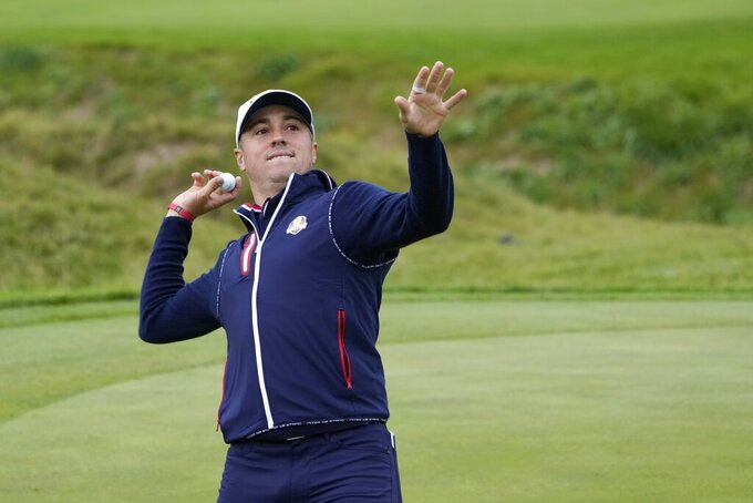 Team USA's Justin Thomas throws a ball to the crowd at the ninth hole during a practice day at the Ryder Cup at the Whistling Straits Golf Course Thursday, Sept. 23, 2021, in Sheboygan, Wis. (AP Photo/Ashley Landis)